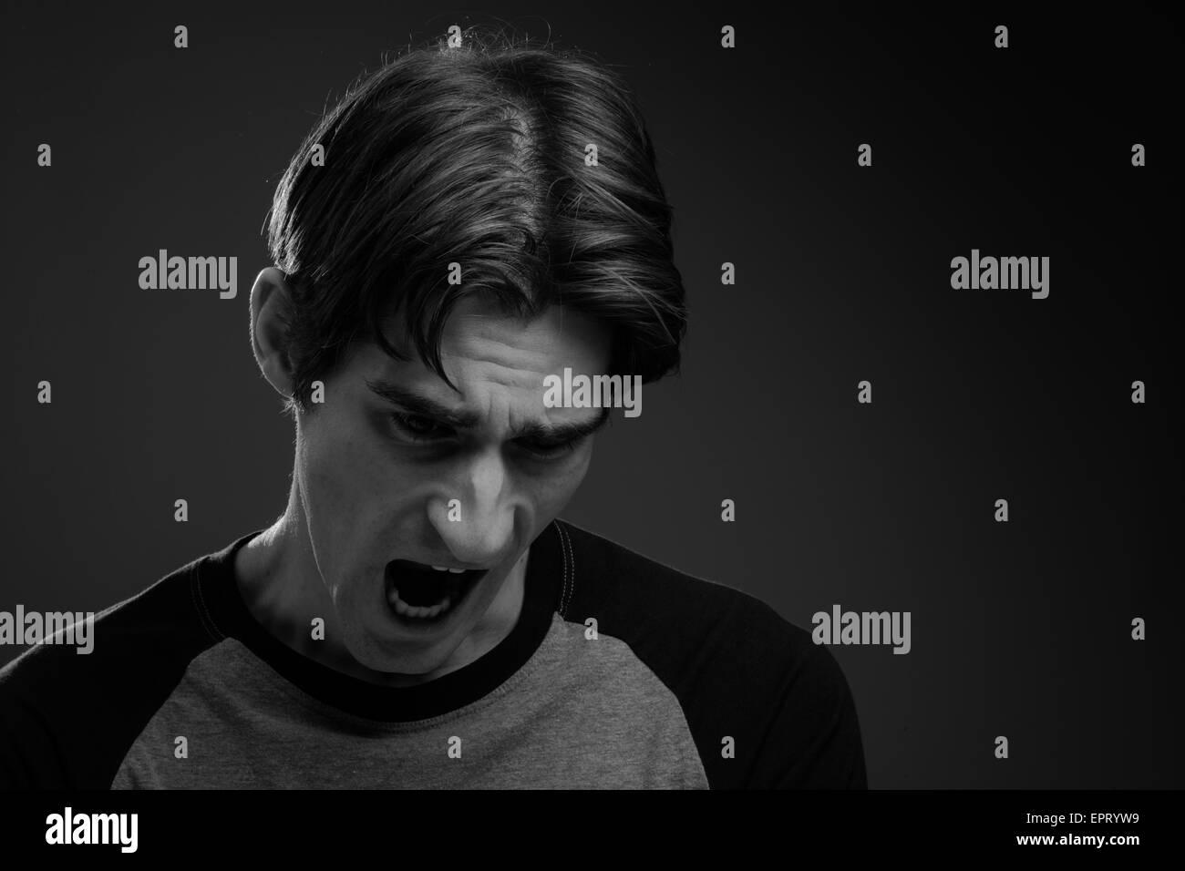 Furious model screaming - Stock Image
