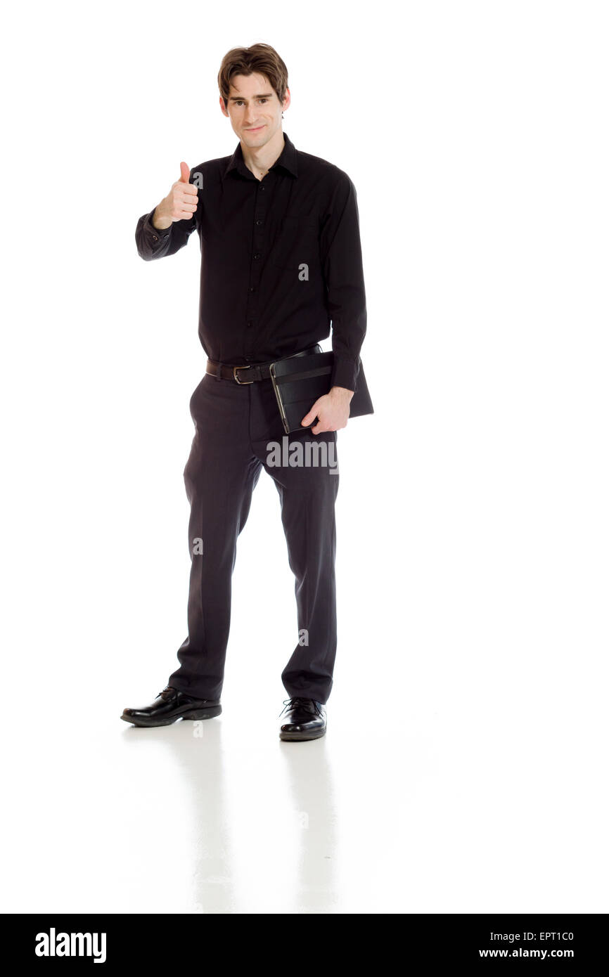 Model isolated on plain background in studio with tumbs up Stock Photo