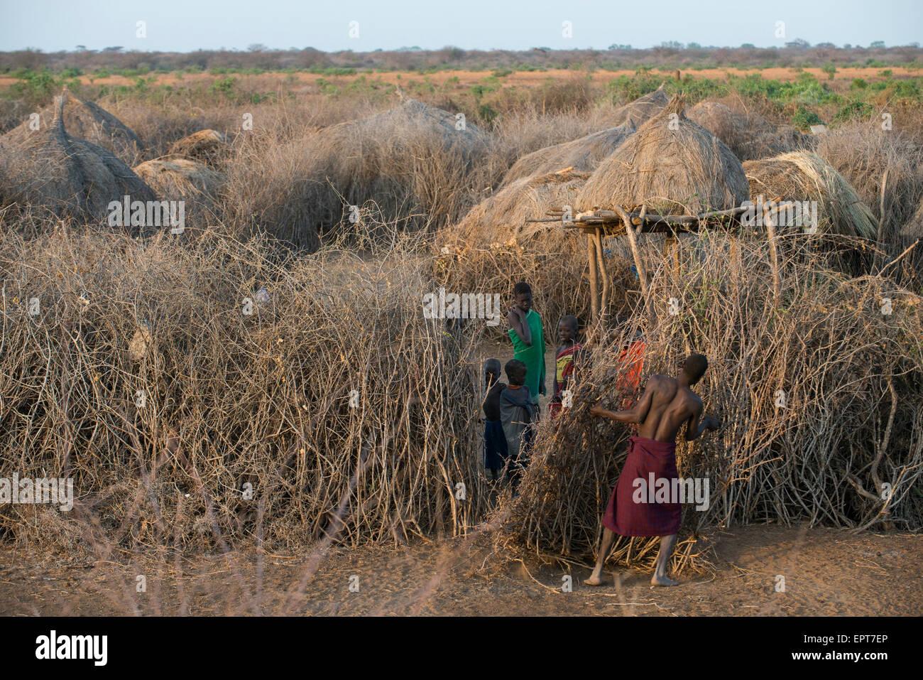 ETHIOPIA, Southern Nations, Lower Omo valley, Kangaten, village Kakuta of Nyangatom tribe, thorn shrub fenced Kral - Stock Image