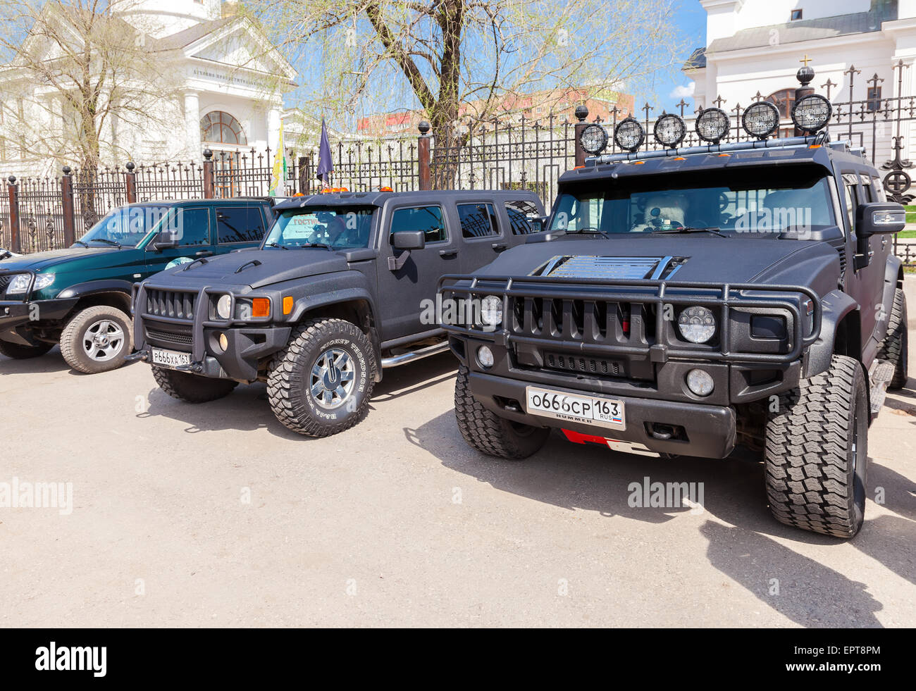 Hummer SUVs on the streets in sunny summer day - Stock Image