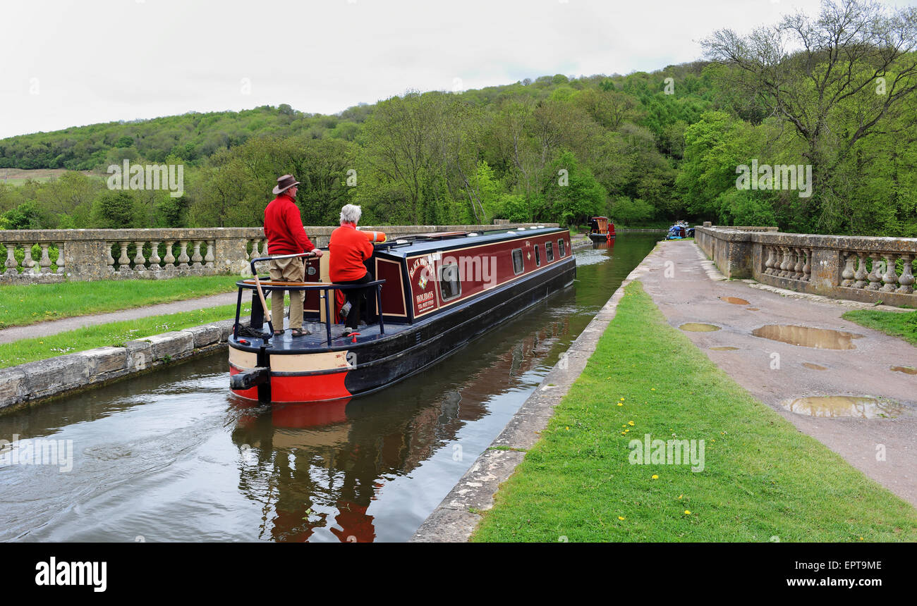Narrowboat crossing a viaduct on the Kennet & Avon Canal in Wiltshire - Stock Image