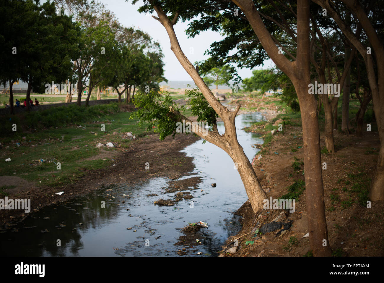 A heavily polluted creek runs through town and into Lake Nicaragua next to Centro Turistico. Centro Turistico is - Stock Image