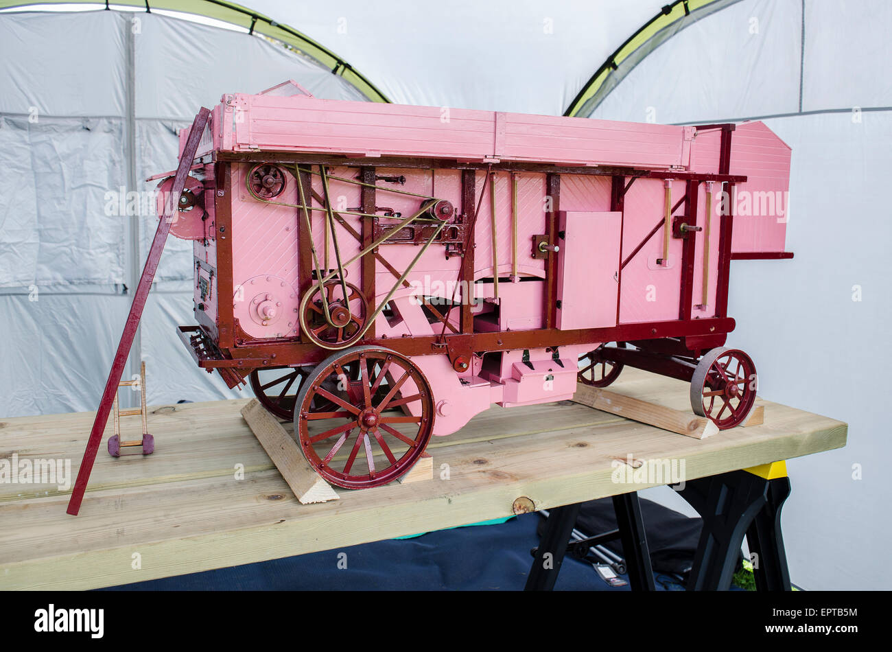 A scale model threshing machine - Stock Image