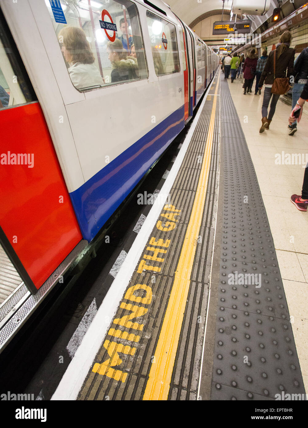 A Mind The Gap sign on the London Underground at a station in Britain Stock Photo