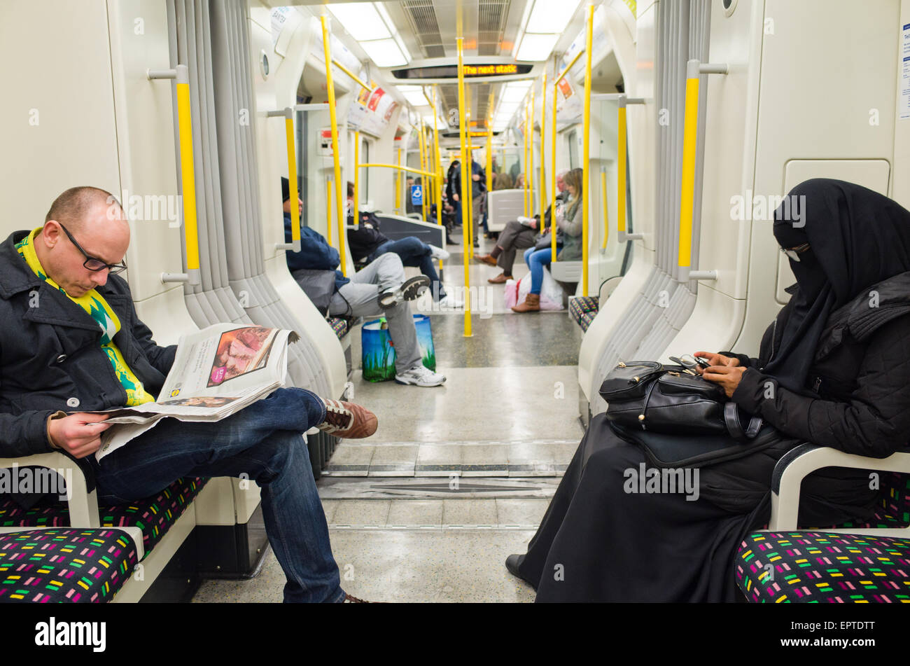 A woman in a burqa  on the London Overground in Britain Stock Photo