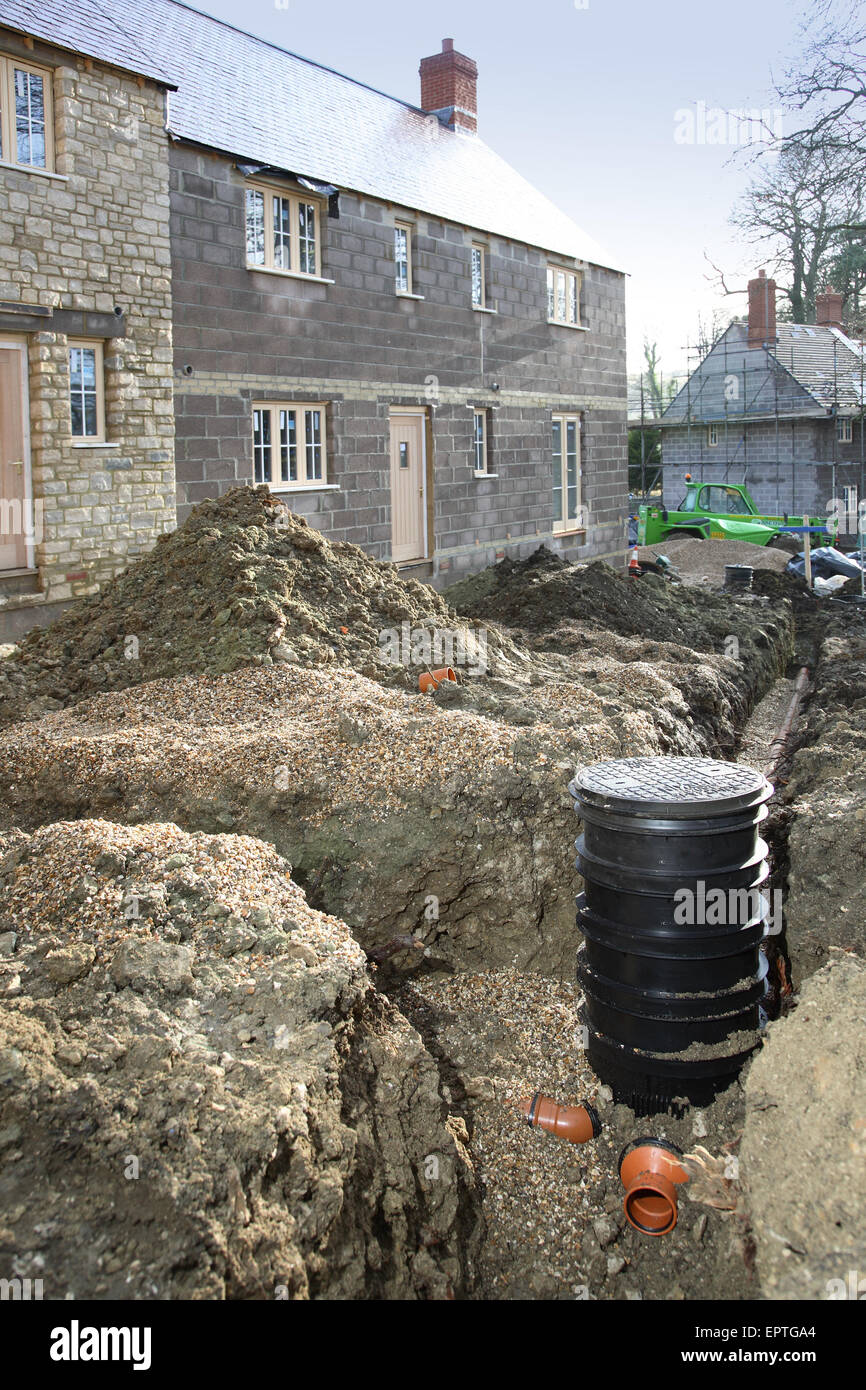 Plastic underground drainage pipes and inspection chamber during installation on a rural housing development in & Underground Drainage Stock Photos u0026 Underground Drainage Stock ...