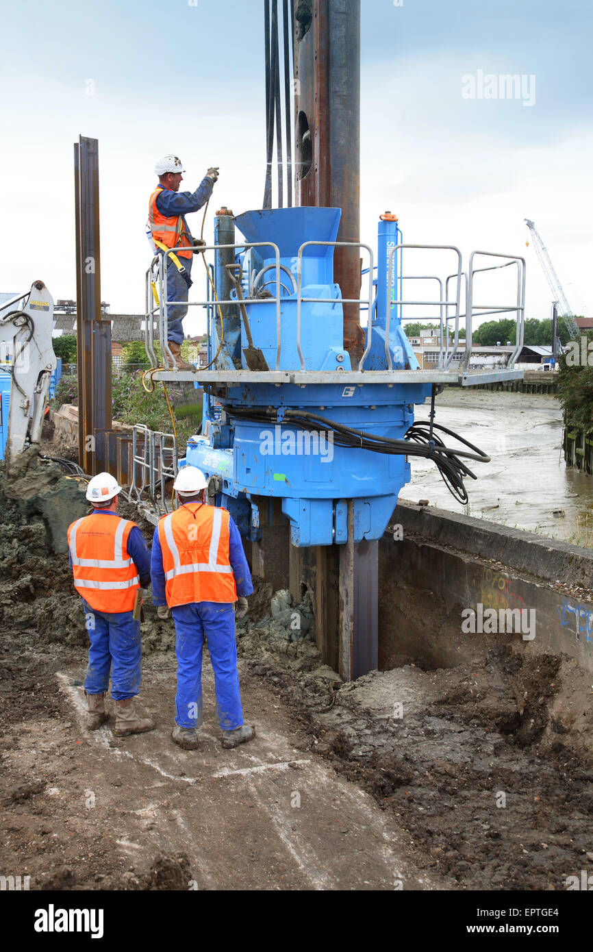 A large piling rig uses a 'silent' vibrating head to install