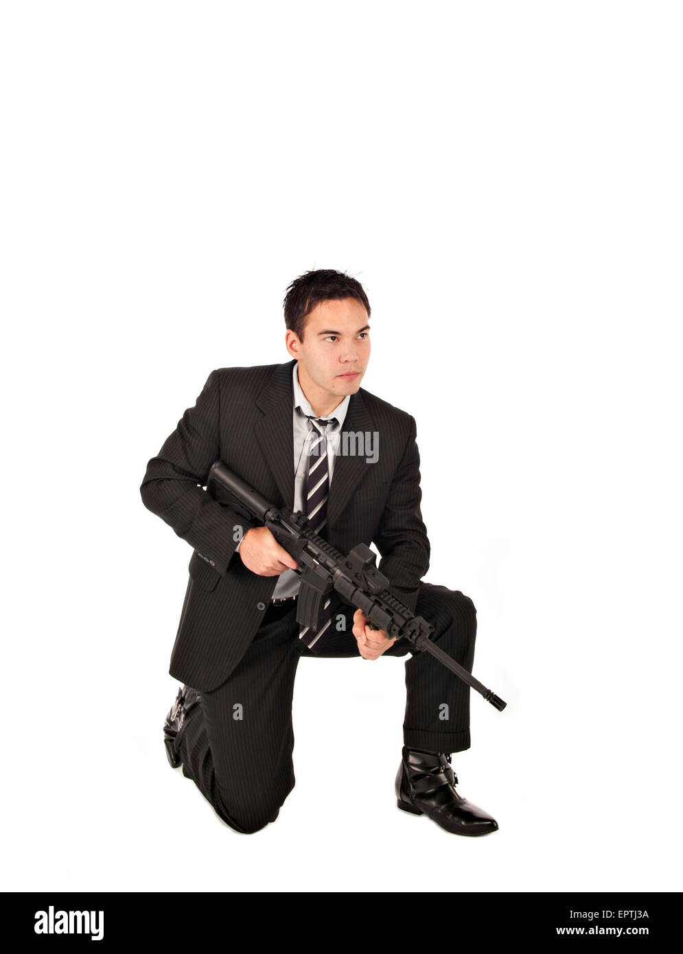 White man kneeling with an AR-15 Semi automatic gun Stock Photo
