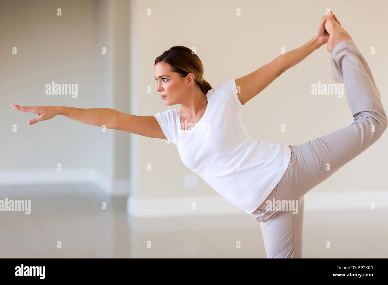 attractive young woman working out at home - Stock Image
