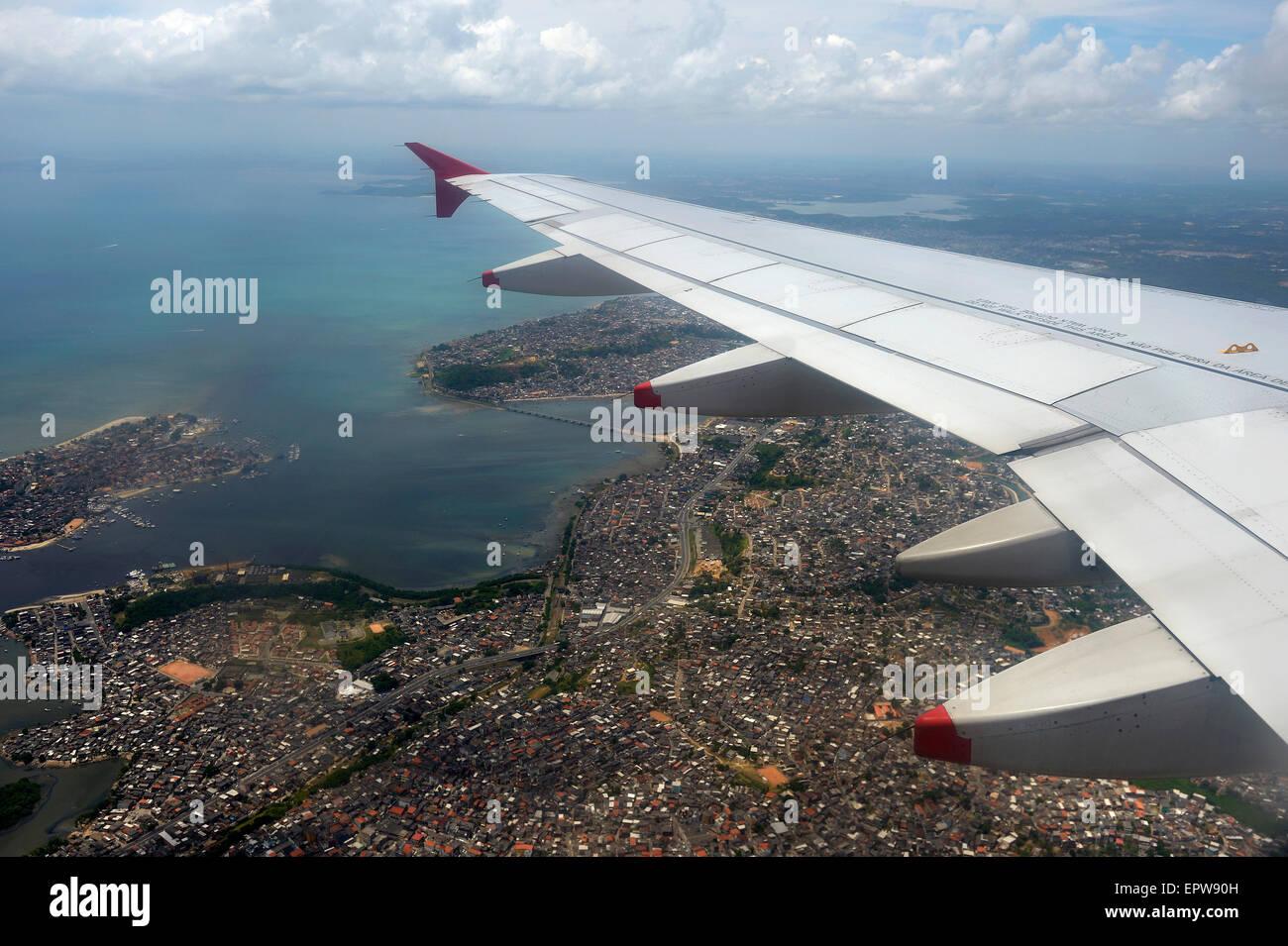 Aerial view with airplane wing, landing at Salvador de Bahia, Bahia, Brazil - Stock Image