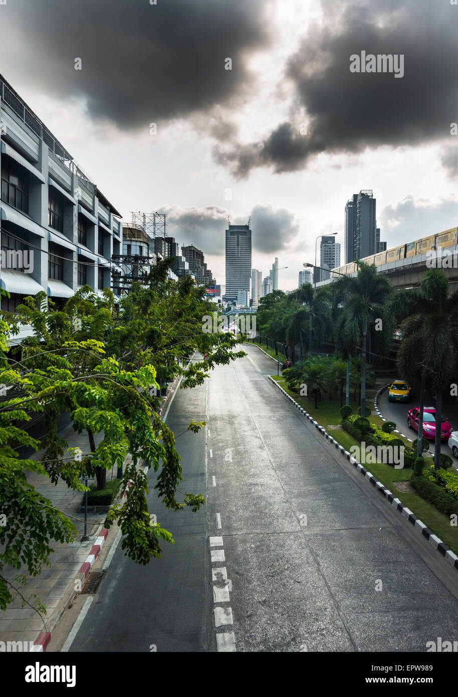 Empty street with skyscrapers behind, Bangkok, Thailand Stock Photo