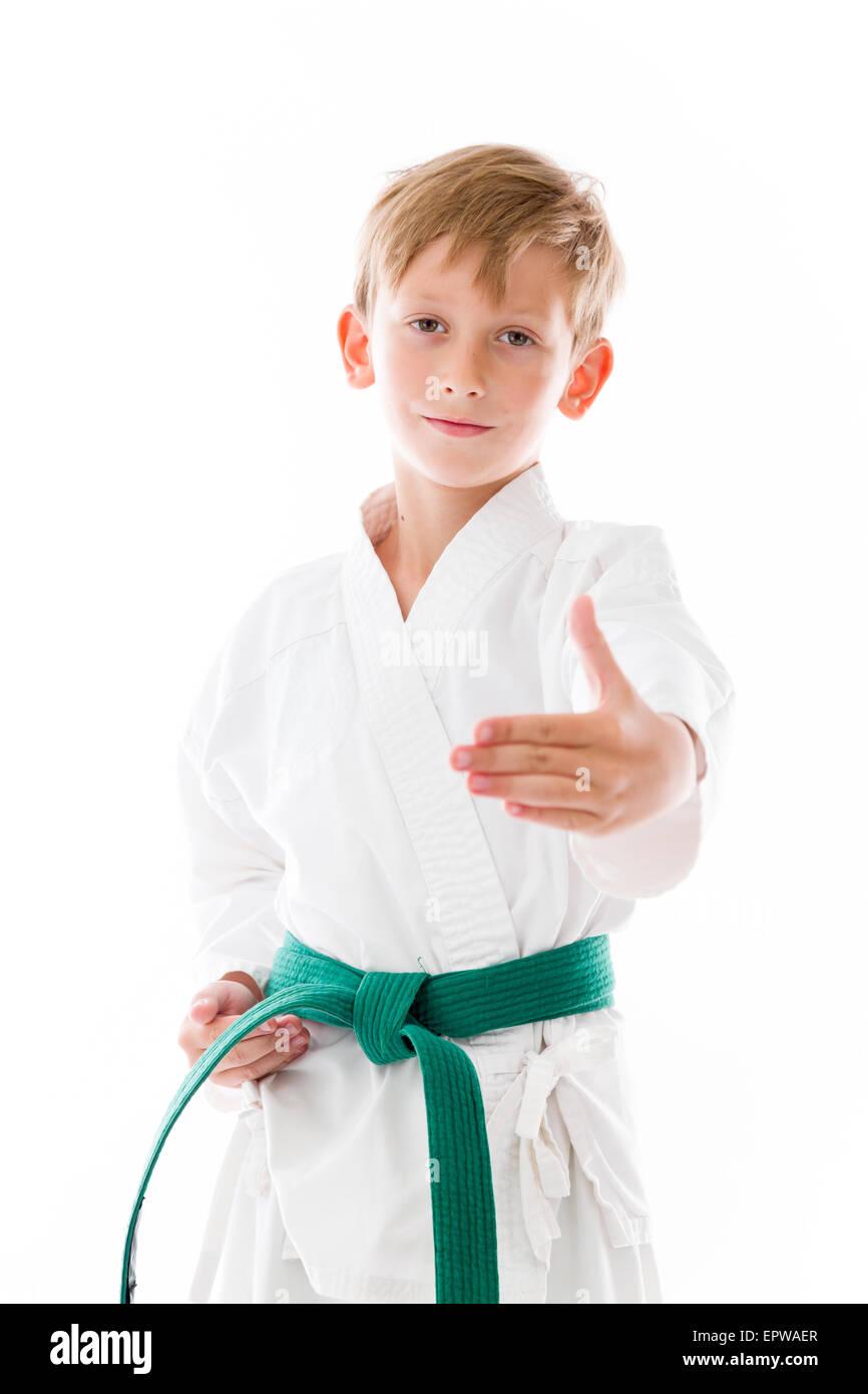 Karate kid in greeting stock photos karate kid in greeting stock model in studio isolated on white background stock image m4hsunfo