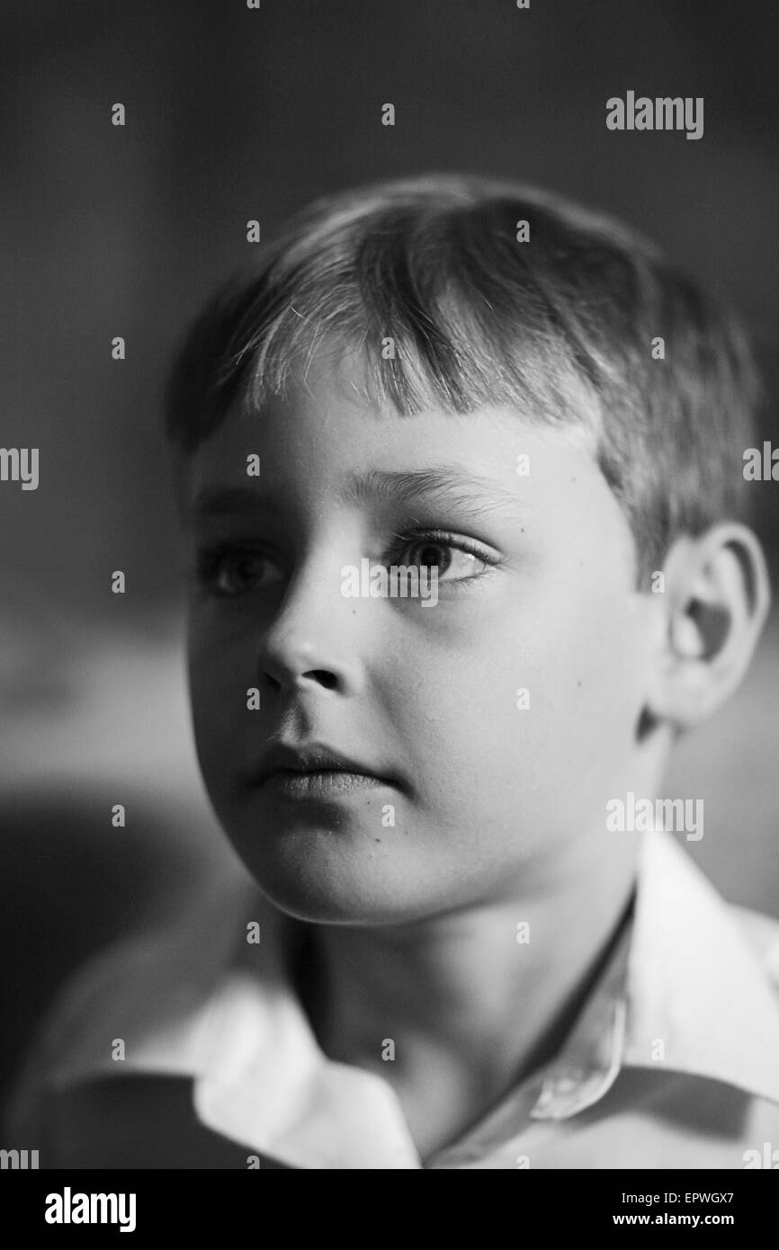 Portrait of a handsome seven year old boy - Stock Image