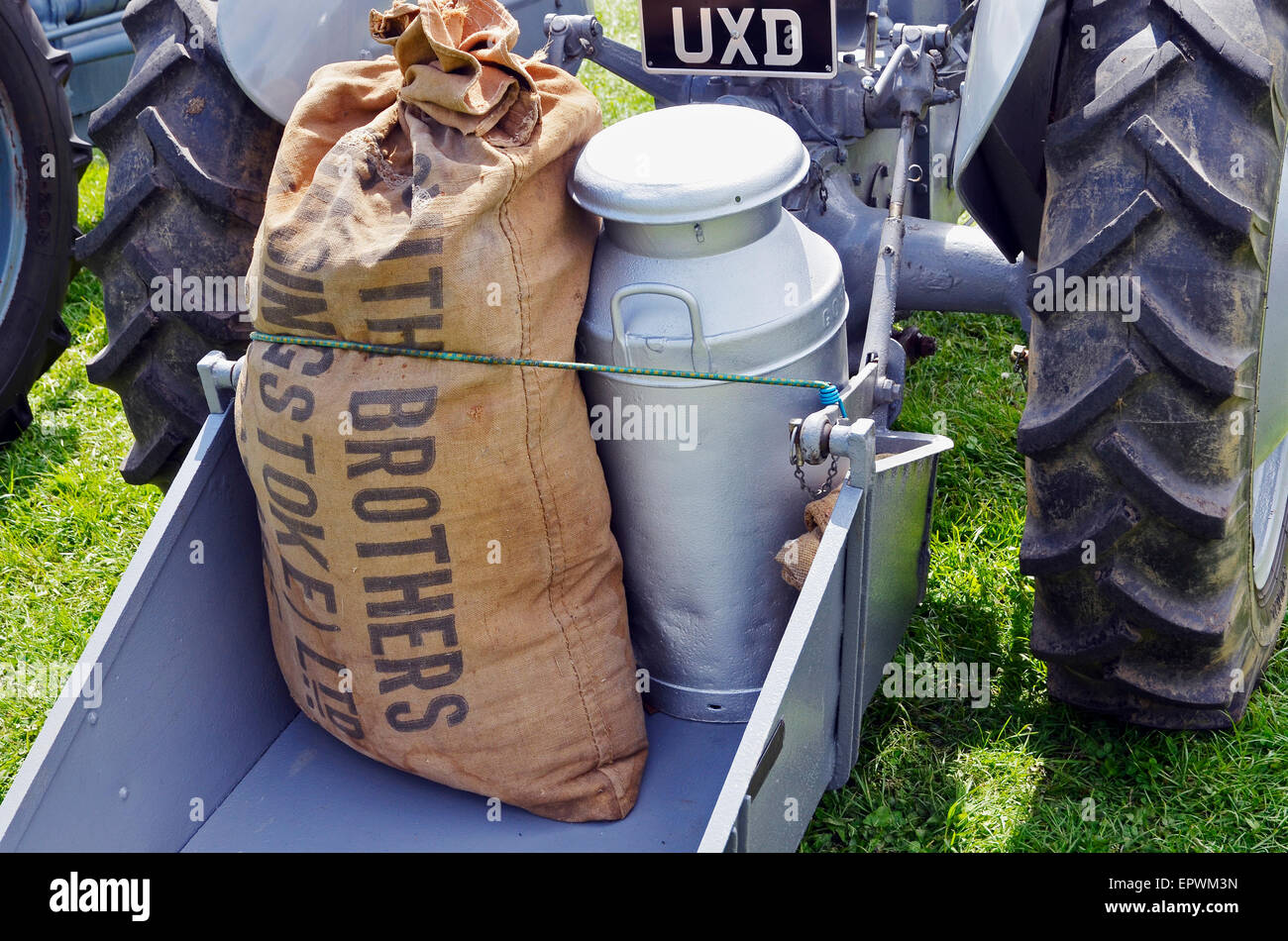 The versatility of the Ferguson tractor system -  sack and churn on a rear bucket platform. - Stock Image