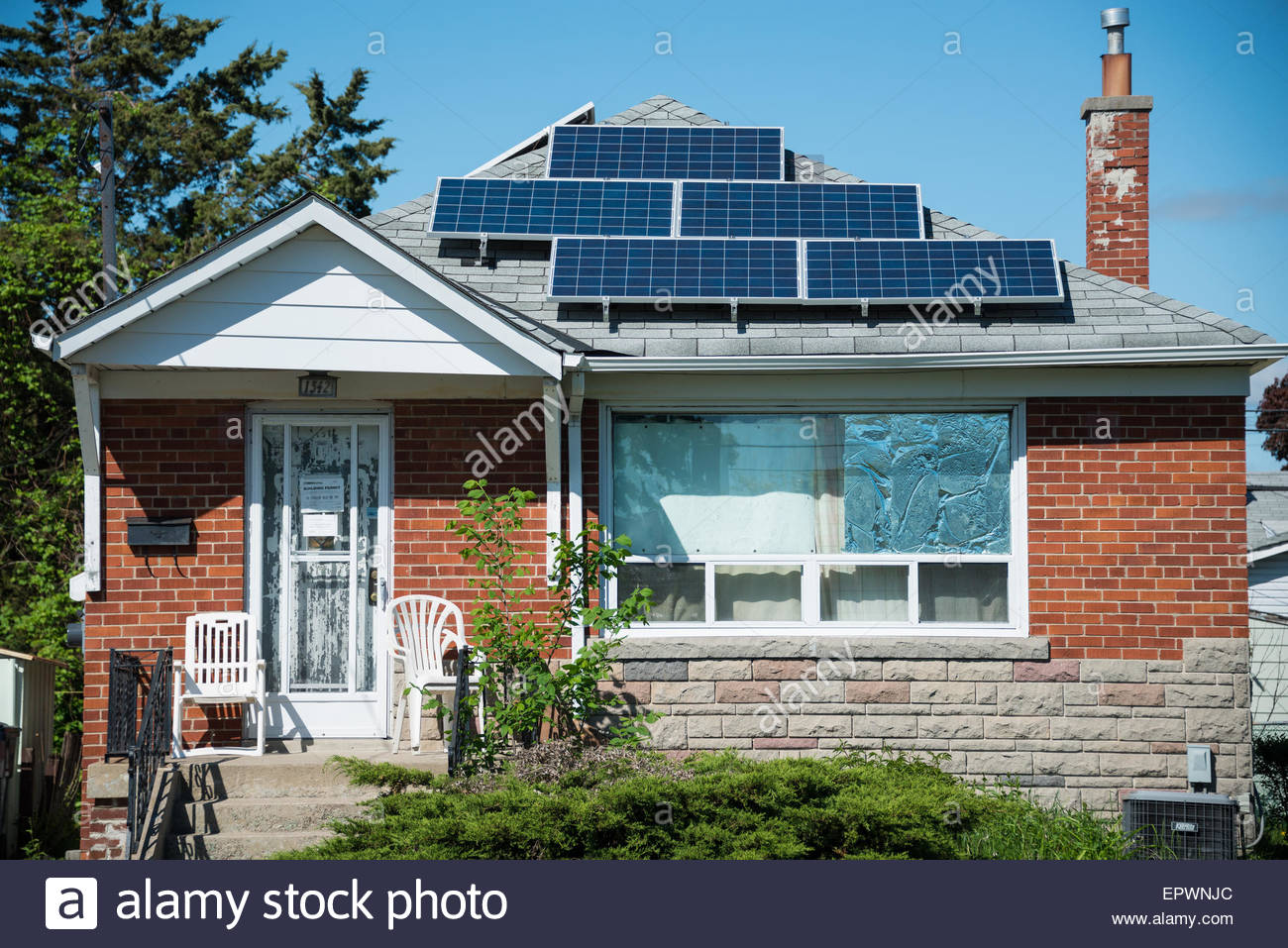 Solar energy panels in private house, practical  use of solar energy is becoming more popular in Canada, some houses - Stock Image