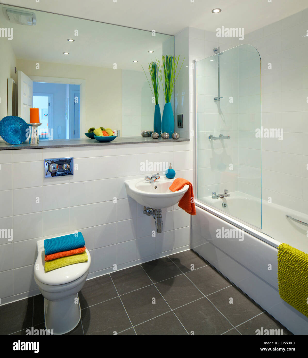 Bathroom with large mirror in new build at Wallis Court Buckshaw Village, a newly-created community Chorley, Lancashire, - Stock Image