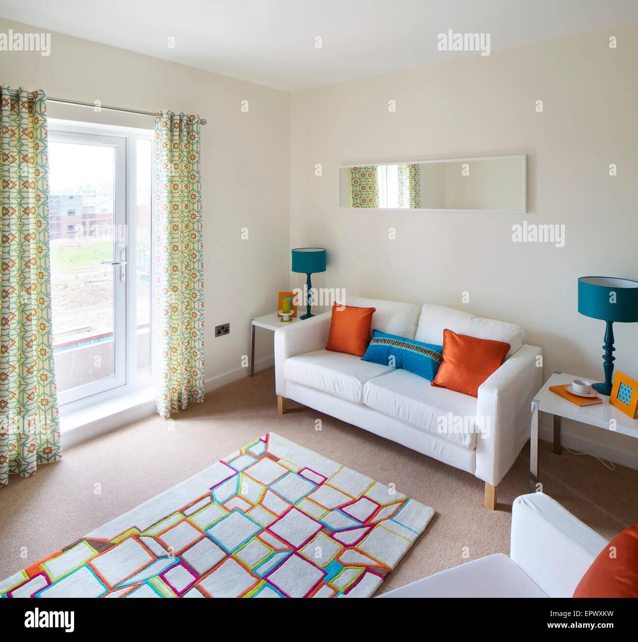 Living room with patio doors in new build at Wallis Court Buckshaw Village, a newly-created community Chorley, Lancashire, - Stock Image