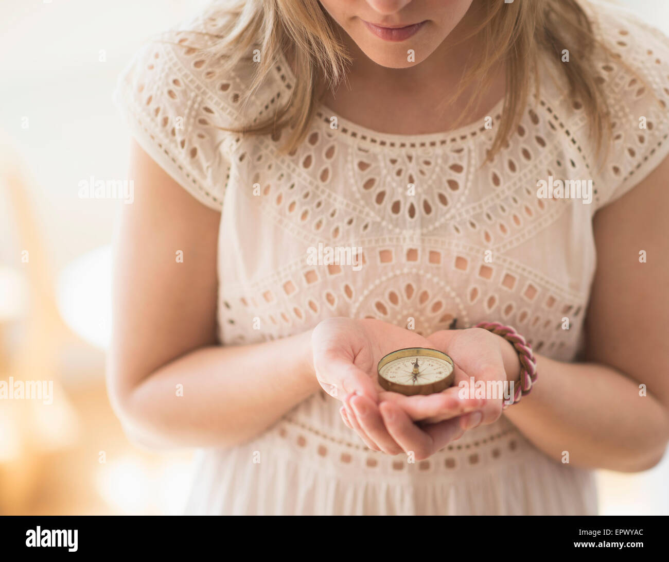Woman holding navigation compass - Stock Image