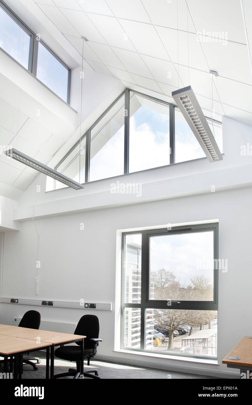 High ceilings with strip lighting in Weston College, 'The Hub', Weston Super-Mare, Somerset, England, UK Stock Photo