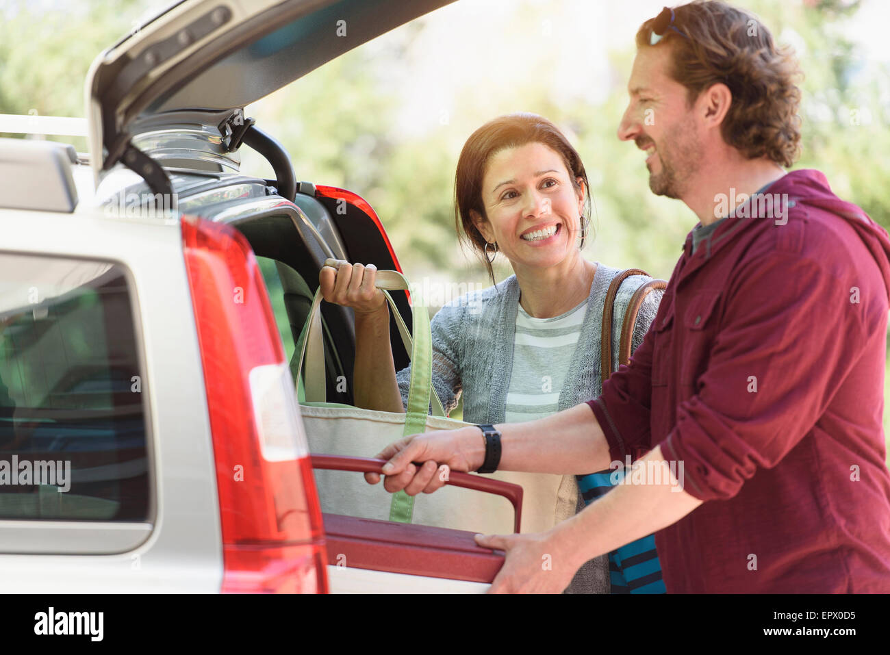 Couple packing their car - Stock Image