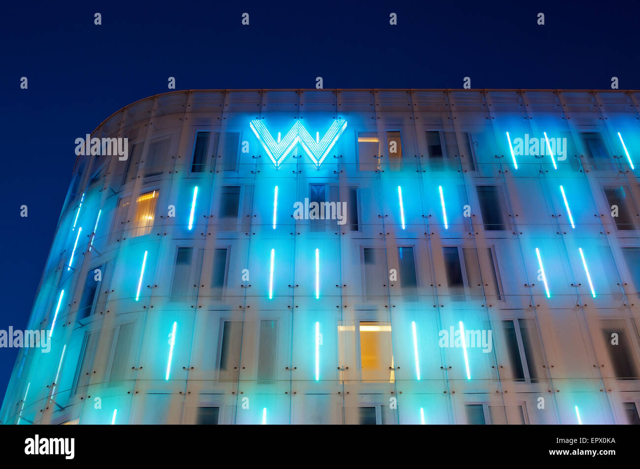Lit neon exterior of W Hotel, Leicester Square, London, England, UK - Stock Image