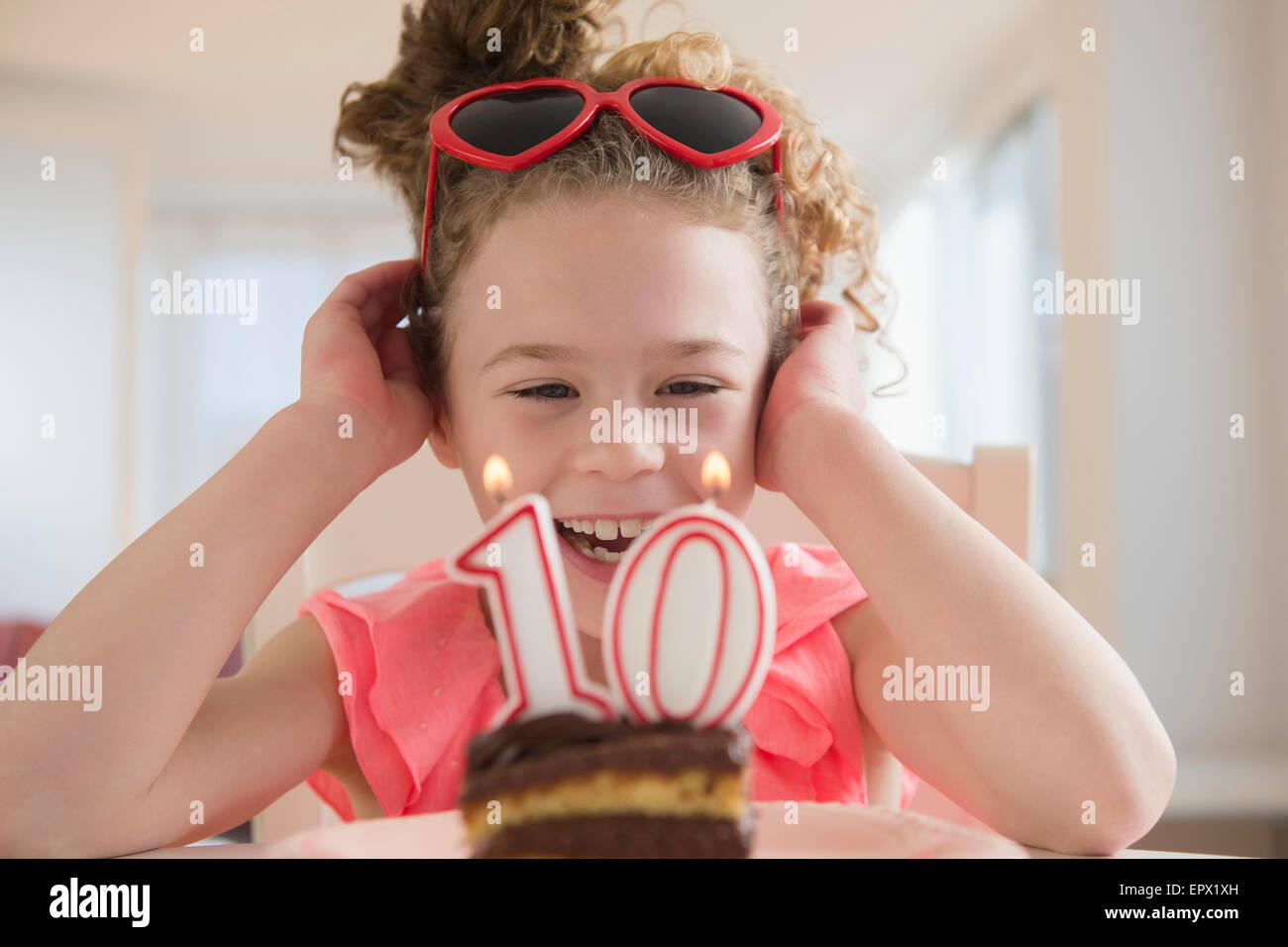 Girl (10-11) celebrating 10th birthday - Stock Image
