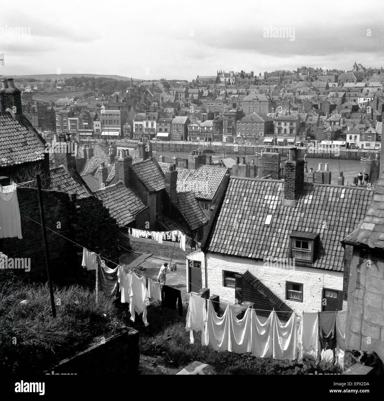 1950s, historical, England, view over victorian terraced housing and town with washing hanging on a clothesline - Stock Image