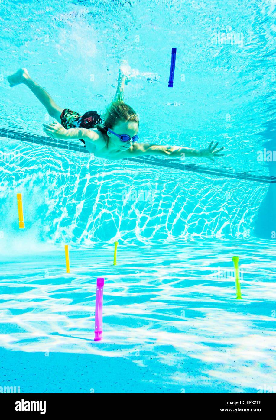 USA, Florida, Jupiter, Boy (8-9) swimming in pool Stock Photo