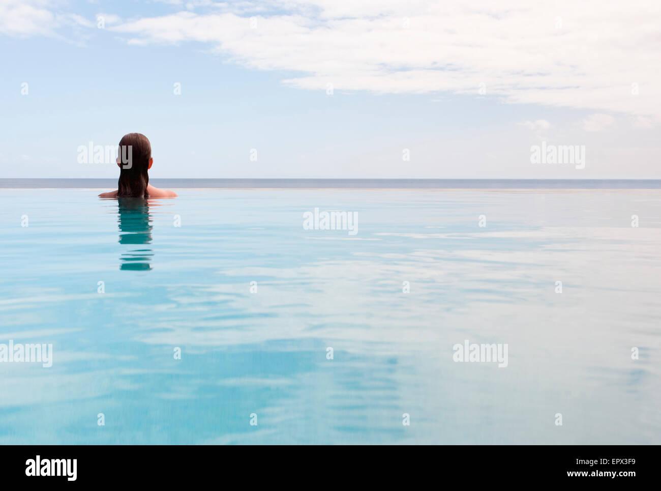 USA, Virgin Islands, St. John, Woman in swimming pool Stock Photo