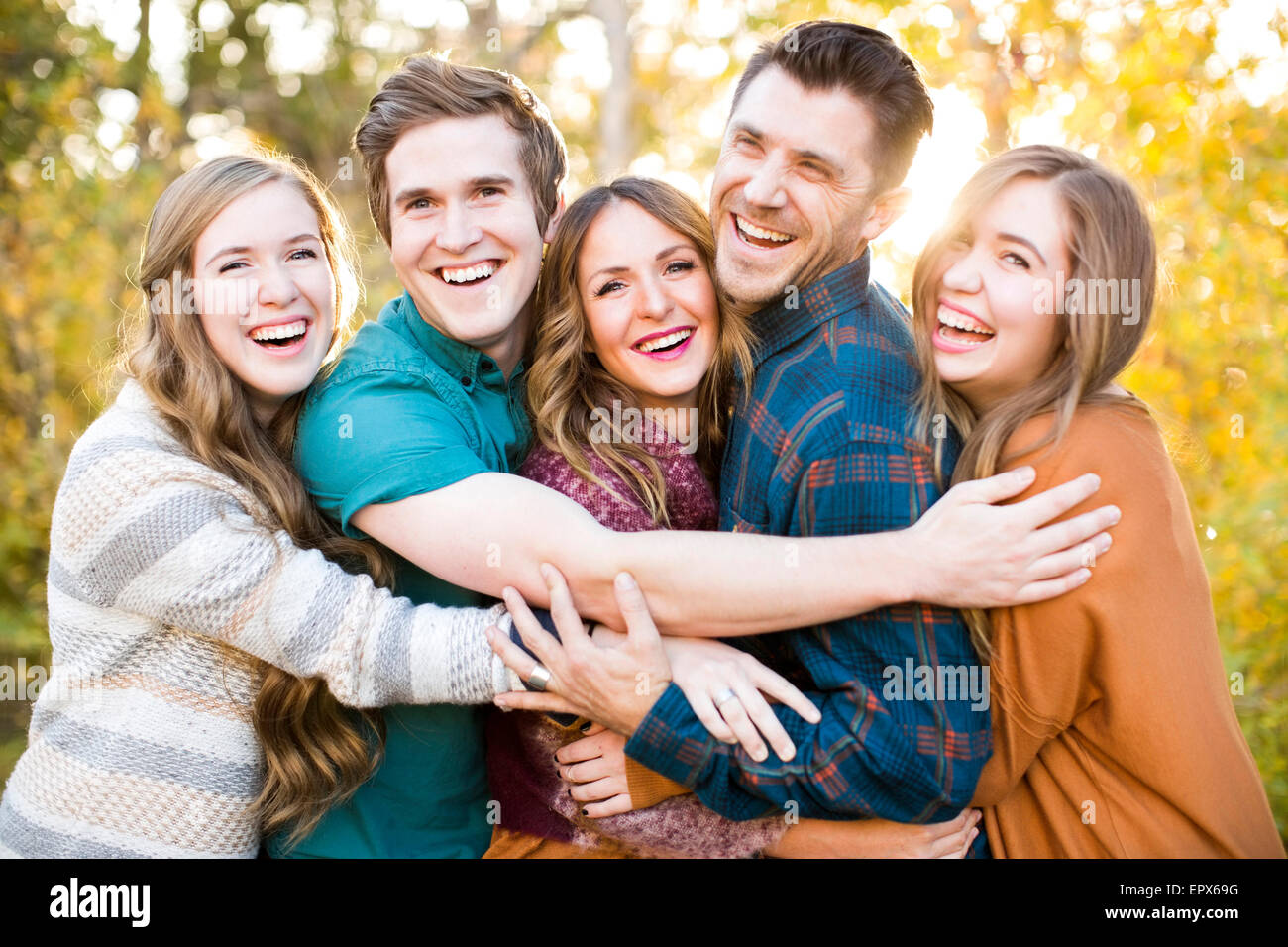Portrait of five smiling friends - Stock Image