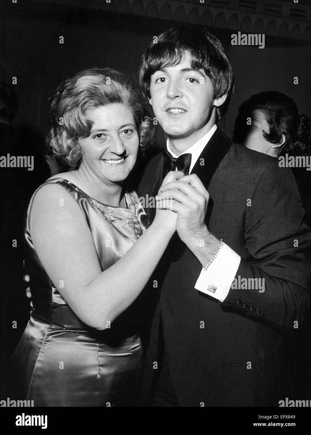 Paul McCartney and his Aunt Joan enjoy a dance at reception held at The Dorchester Hotel, London, after Royal charity - Stock Image