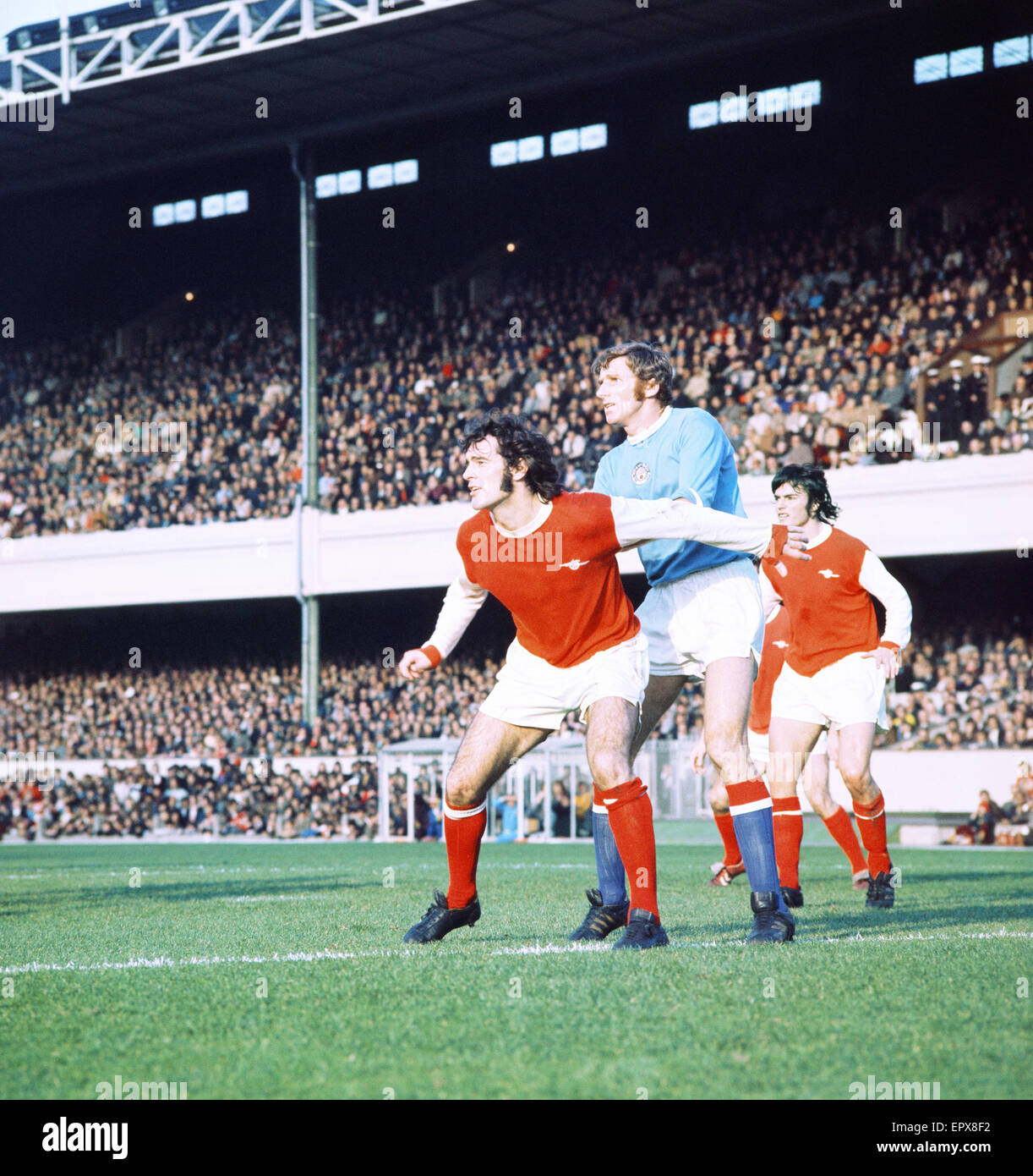 English League Division One match at Highbury. Arsenal 0 v Manchester City 0. Arsenal's Peter Storey challenged - Stock Image