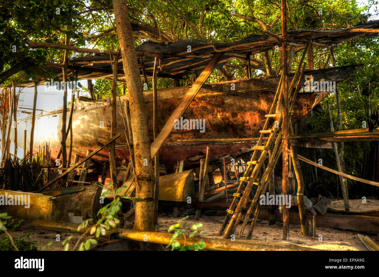 Traditional wooden boat building yard La Digue Seychelles - Stock Image