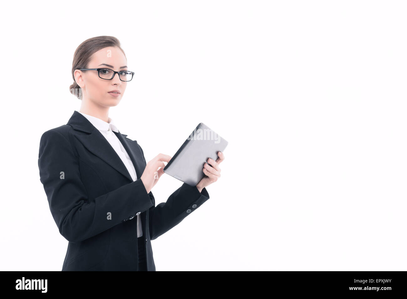 Beautiful woman with tablet in formal clothes - Stock Image