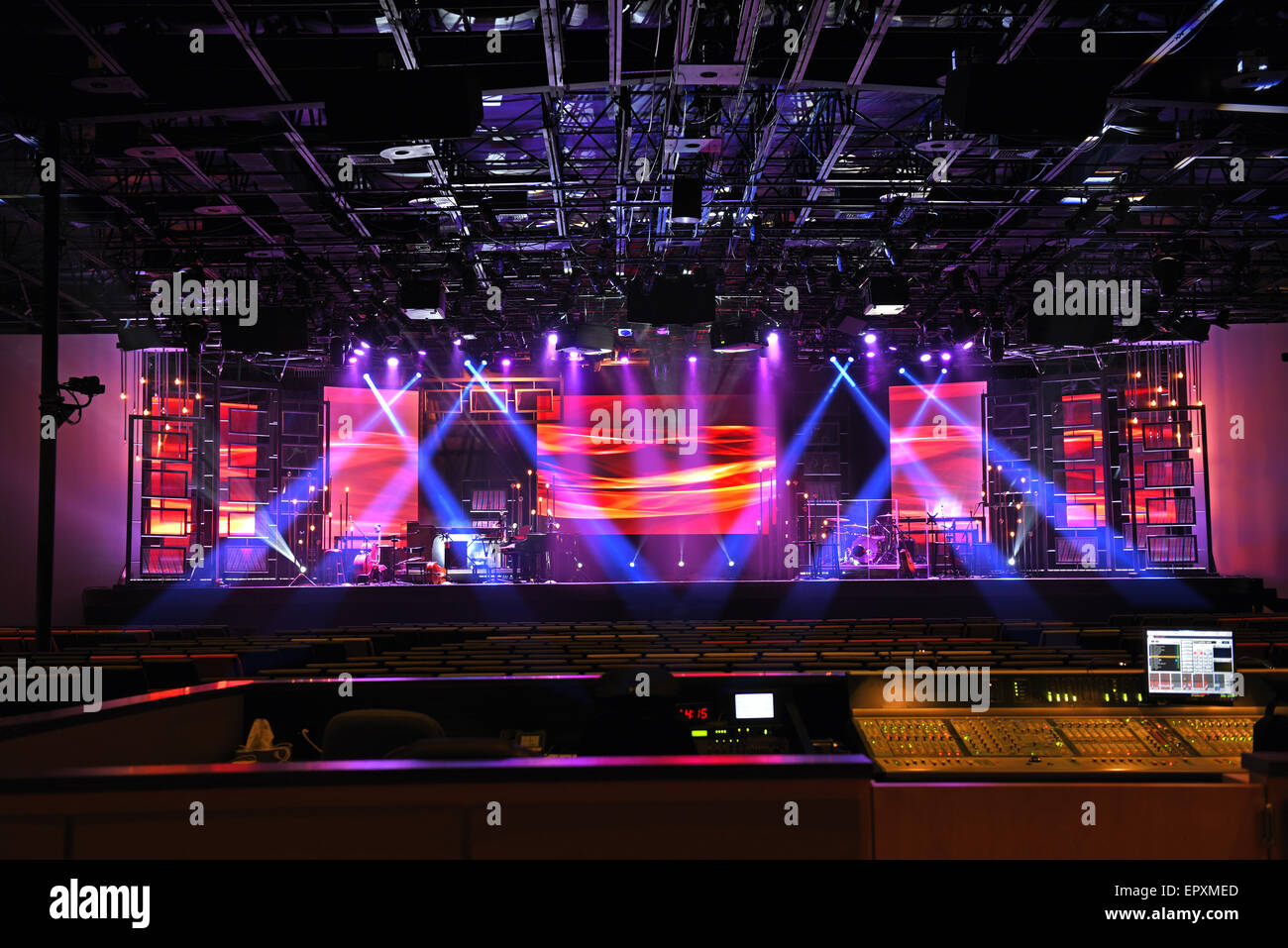 Concert stage lights with electronic console in foreground - Stock Image