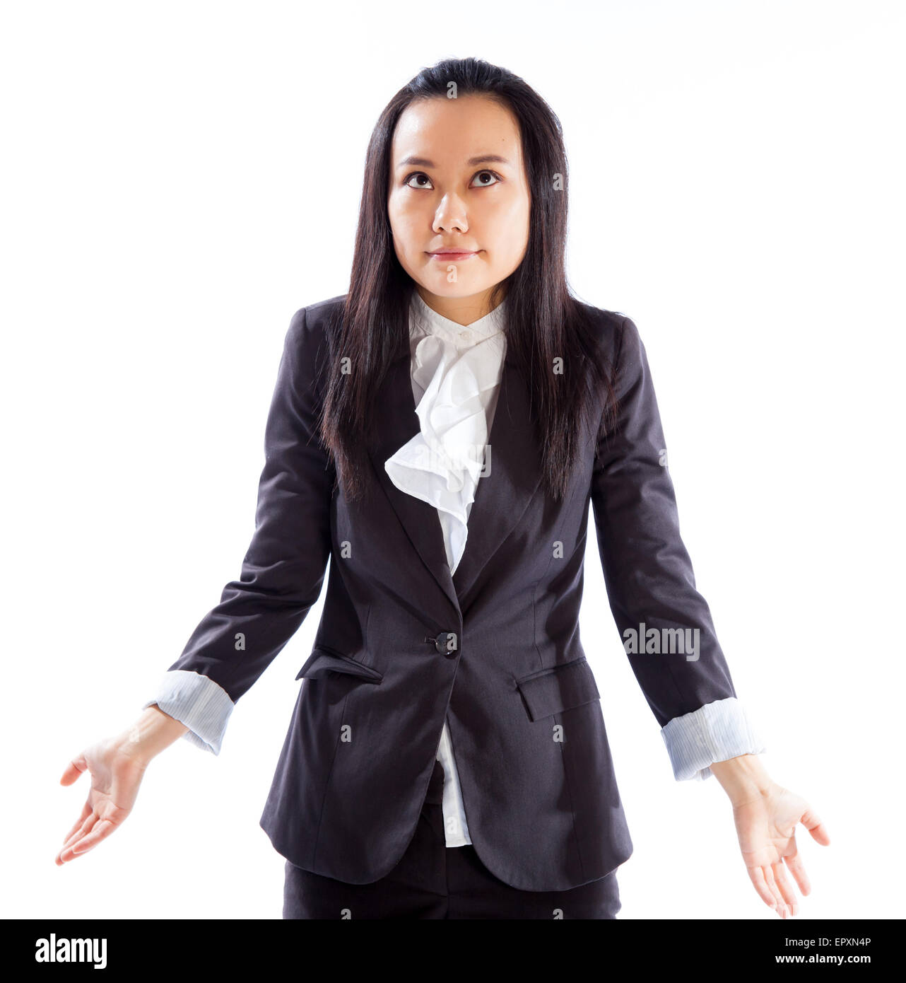 Attractive asian girl in her 30s shot in studio isolated on a white background - Stock Image