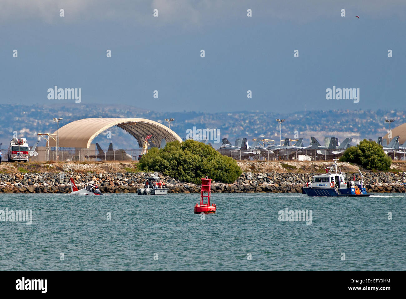 A U.S. Navy T-45C training jet crashed into San Diego Bay while the pilot was attempting to land at Naval Air Station - Stock Image