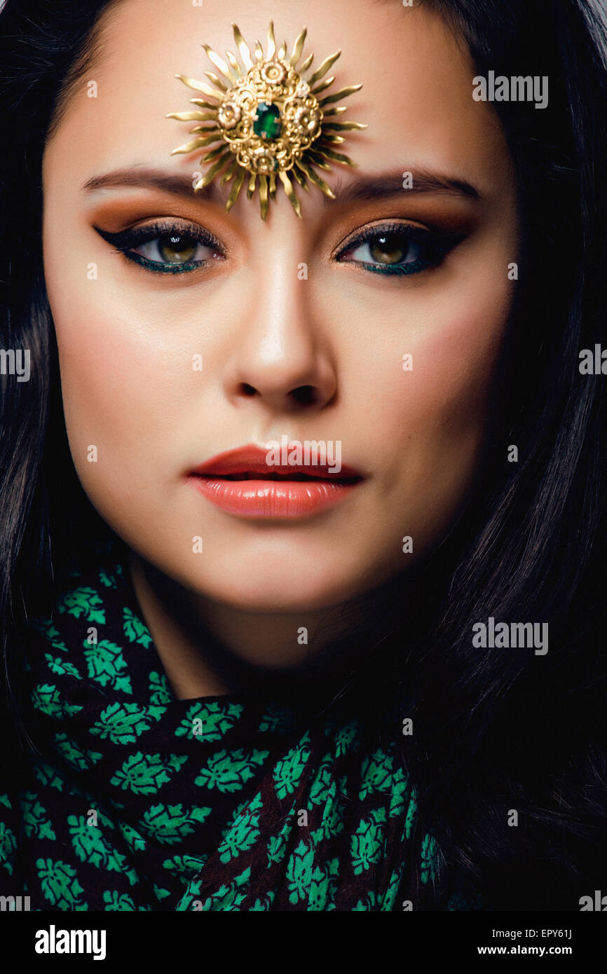 beauty eastern woman with jewelry close up, bride star brooch - Stock Image