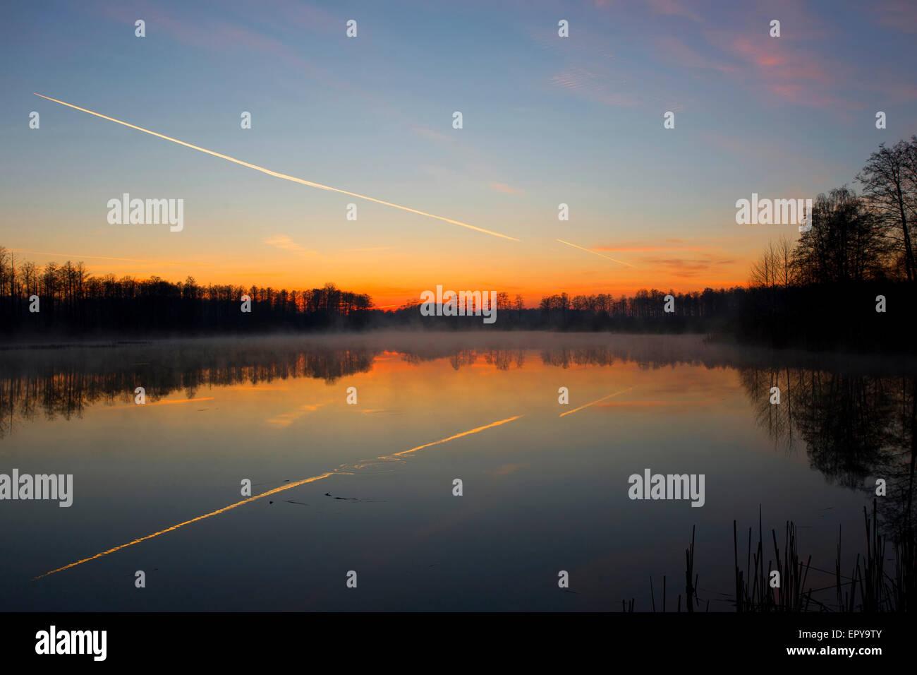 Sunrise over the lake - Stock Image