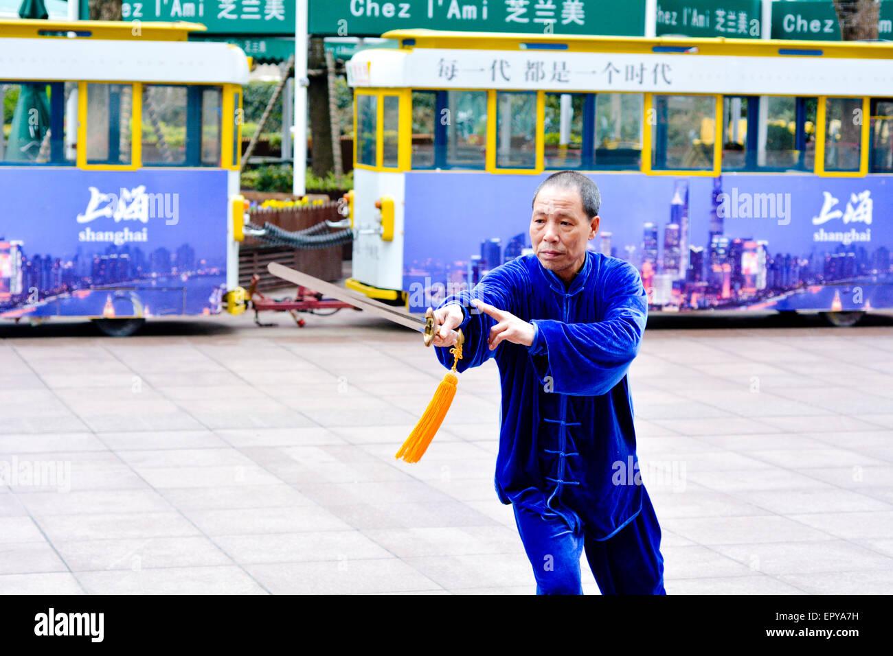 SHANGHAI, CN - MAR 17 2015:Chinese man practice Tai Chi in Nanjing Road Shanghai China.It is an internal Chinese - Stock Image
