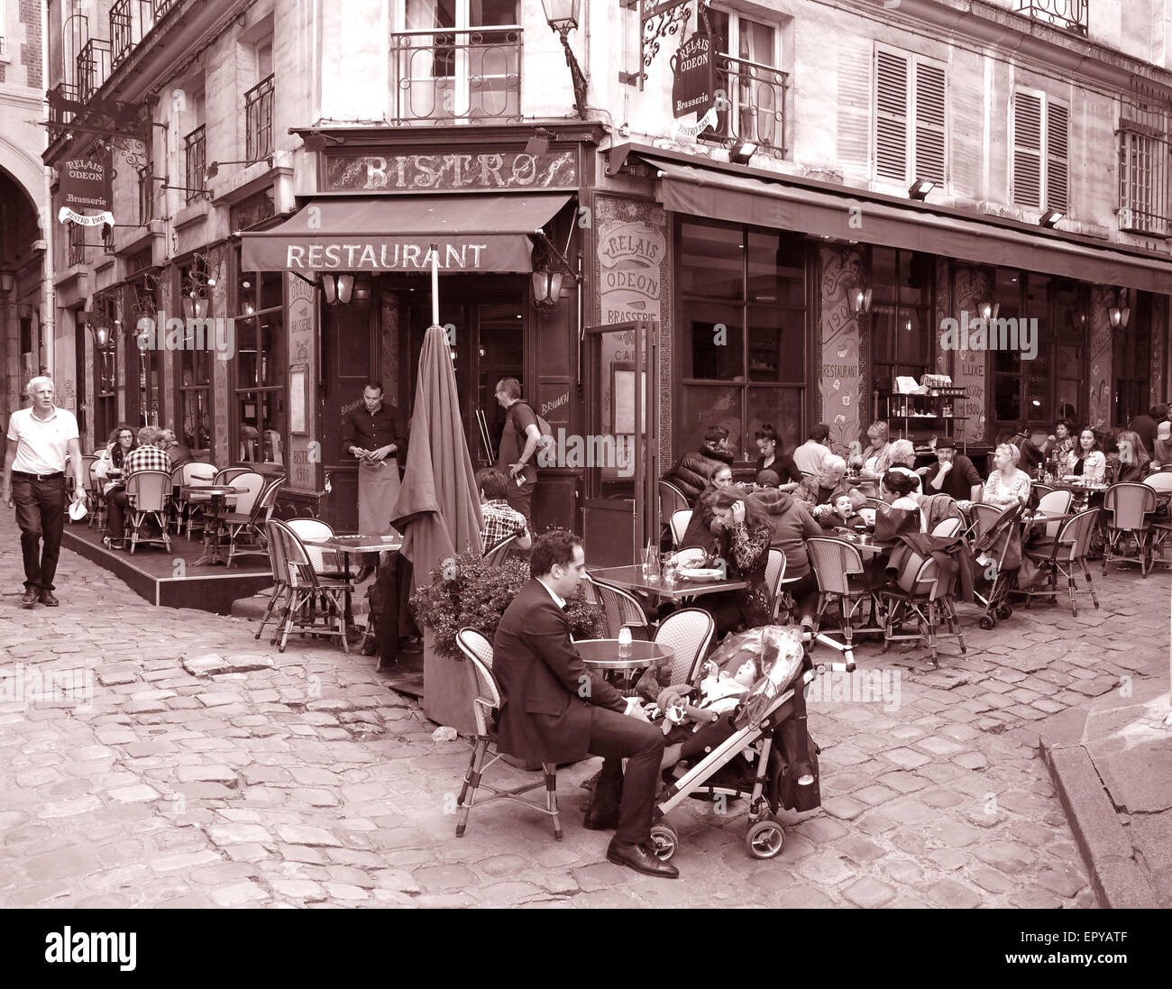 Paris restaurant bistro teracce.father and child - Stock Image
