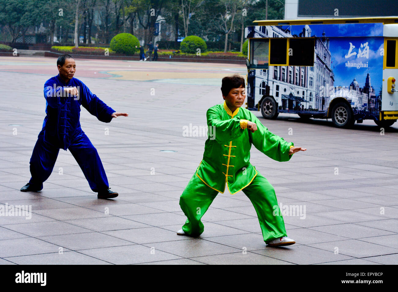 SHANGHAI, CN - MAR 17 2015:Chinese couple practice Tai Chi in Nanjing Road Shanghai China.It is an internal Chinese - Stock Image
