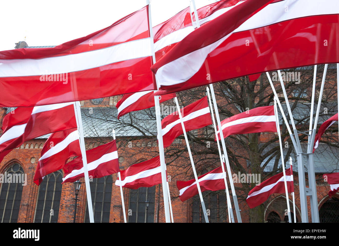 Latvian flags in front of the Riga Cathedral, Riga, Latvia Stock Photo