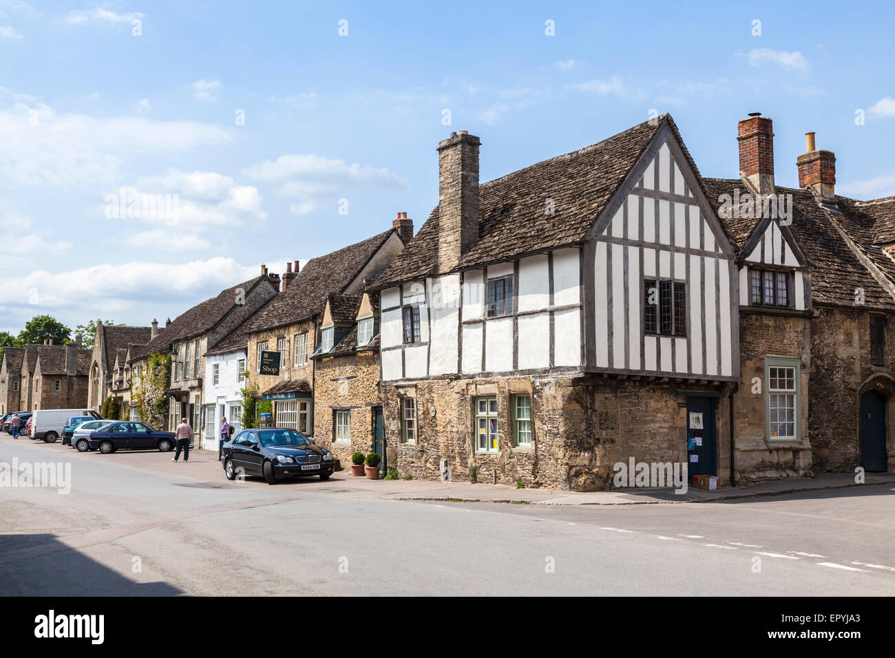 Lacock High Street with traditional old-fashioned and unspoilt timbered cottages, Lacock, Wiltshire, UK - Stock Image