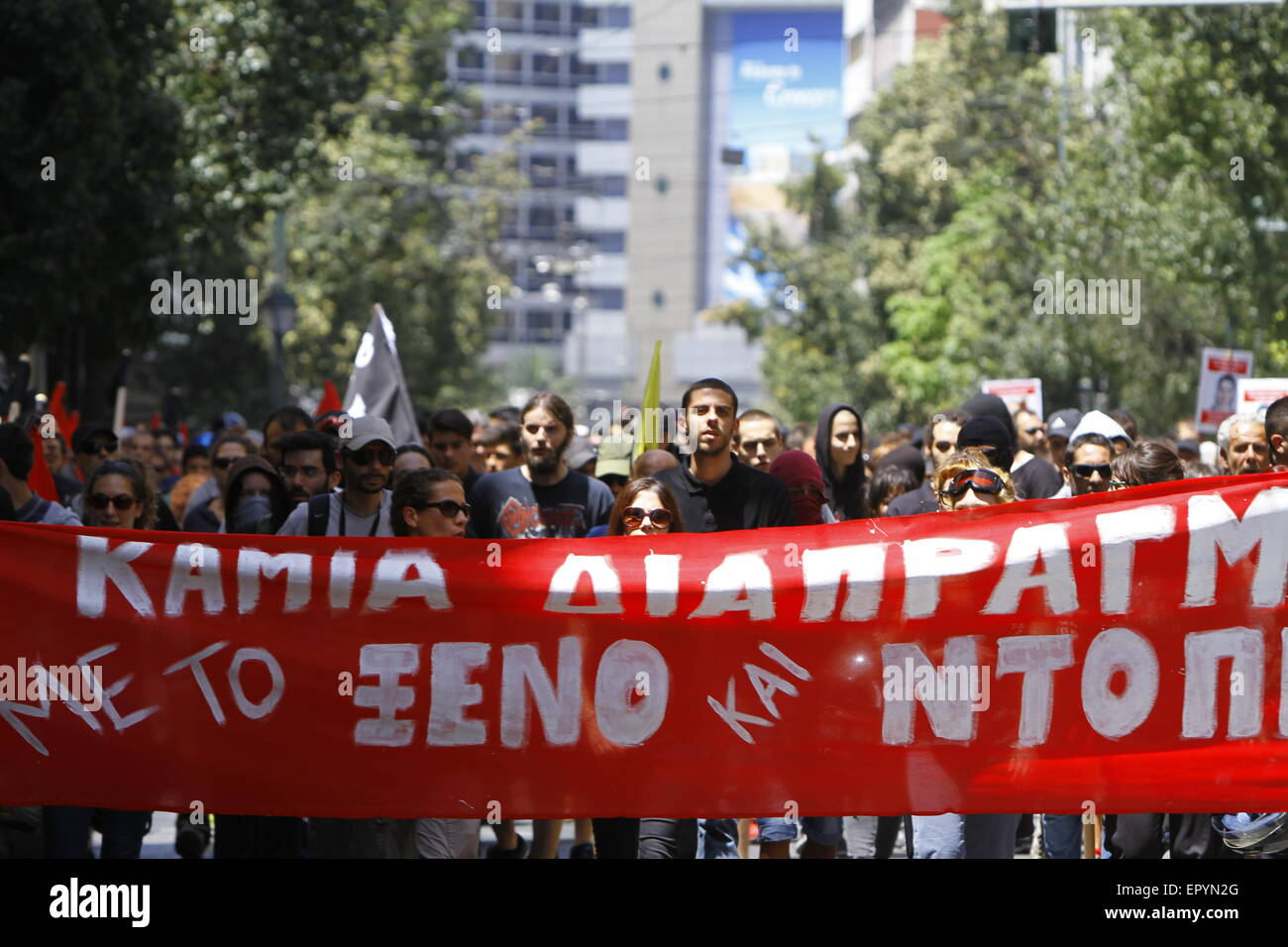 Athens, Greece. 23rd May 2015. Greek anarchists march from Omonia Square to the German Embassy. A large poster reading - Stock Image