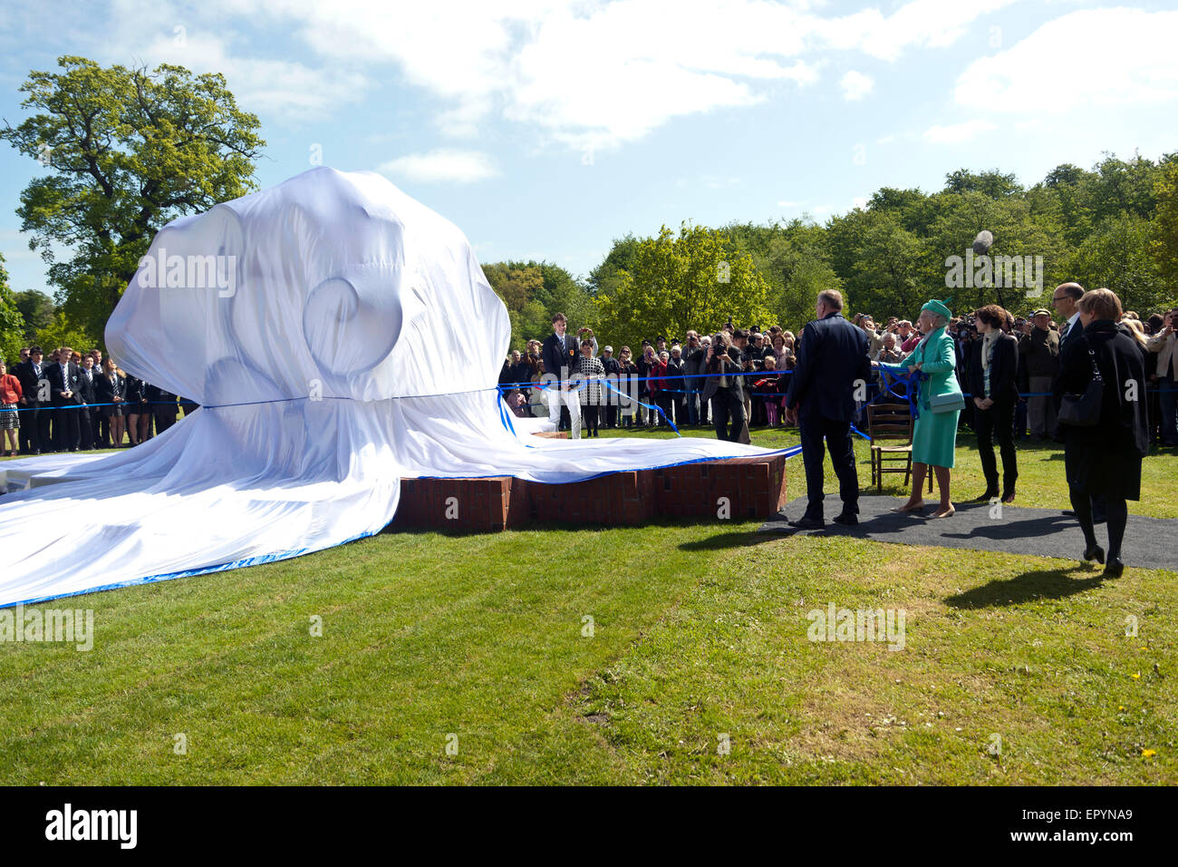 Naestved, Denmark, May 23rd, 2015: H. M. Queen Margrethe (4th, R) unveils a statute in Herlufsholms garden, but - Stock Image