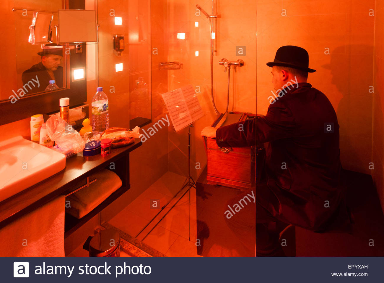 theatre performance in a hotel room shower - Stock Image