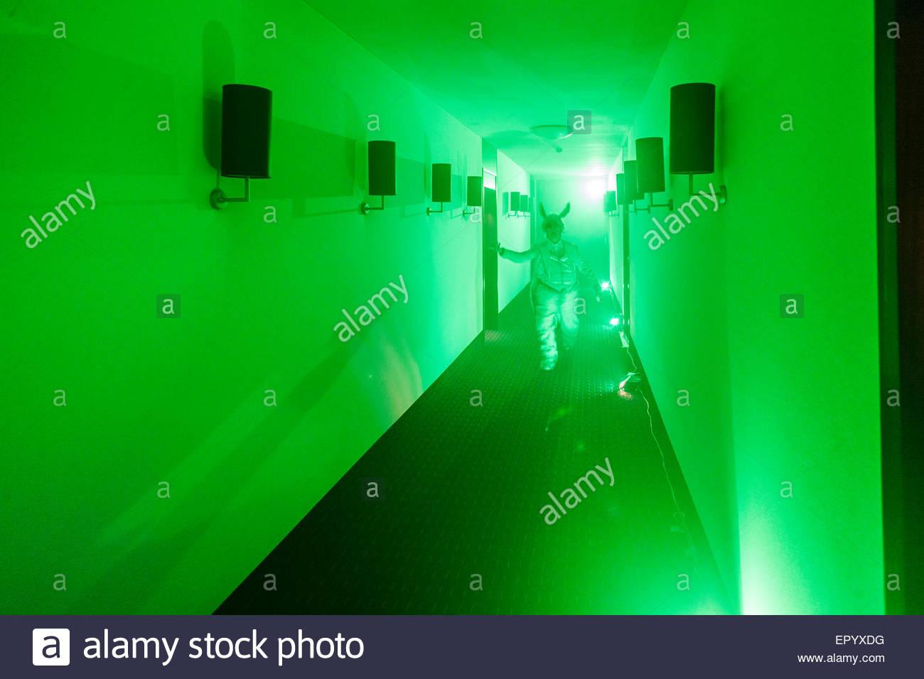 theater performance on hotel corridor - Stock Image