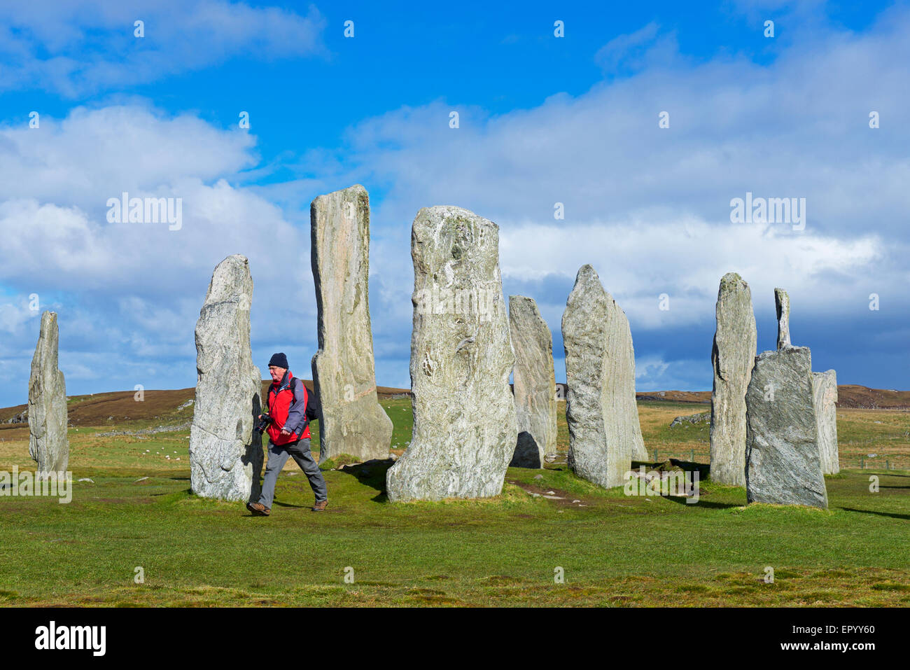 Man walking between the Callanish Stones, Isle of Lewis, Outer Hebrides, Scotland UK - Stock Image