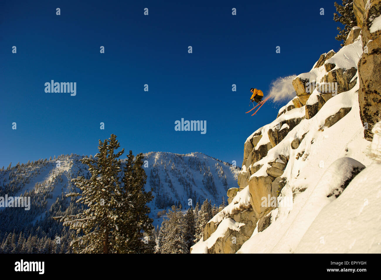 Big air cliff jump on skis with Mt. Rose Ski Tahoe in the background. Stock Photo